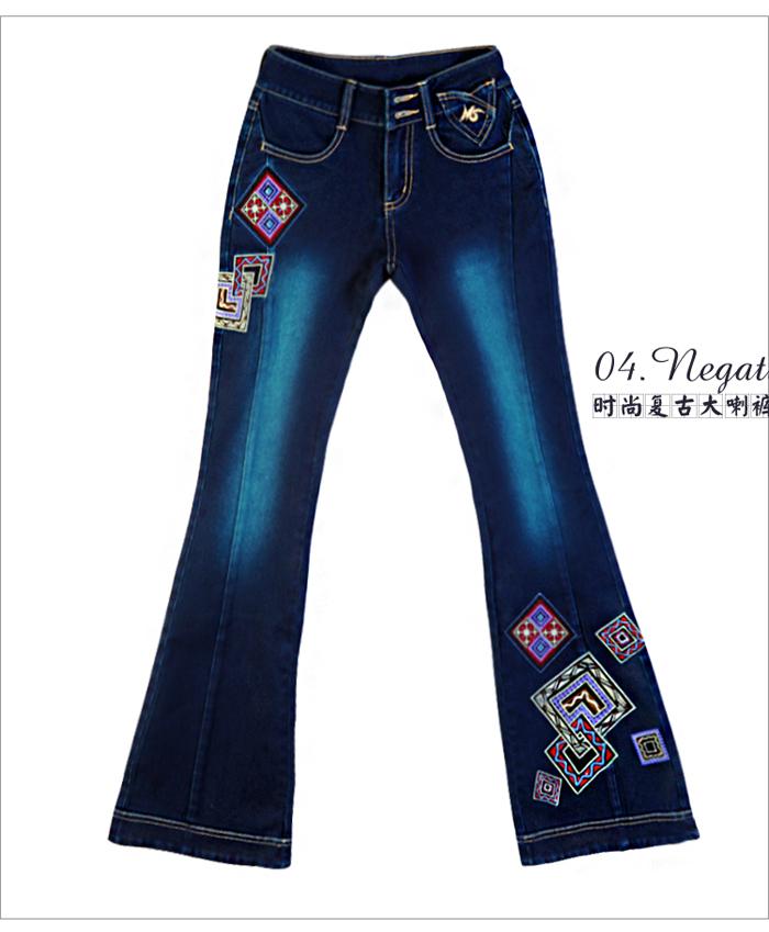 曼佳合微喇女裤修身长裤新款绣花牛仔裤中腰刺