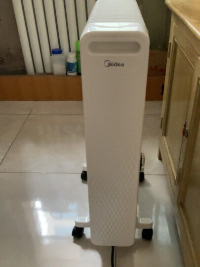 美的 油汀取暖器家用电暖器13片油丁电暖气片电热暖风机电油汀取暖器片暖手宝电暖炉 晒单图