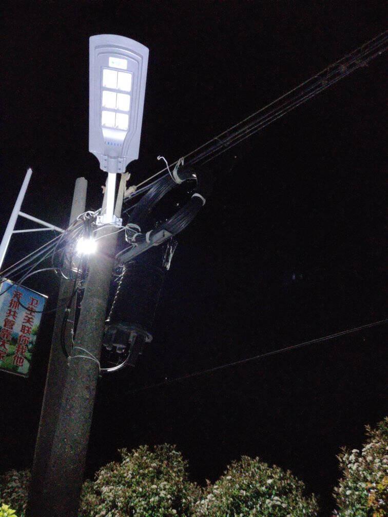 致点太阳能灯户外家用高亮庭院灯新农村路灯LED壁灯投光灯防水室外围墙灯零点费免布线新能源灯智能感应款-50瓦二灯杯-照100平方